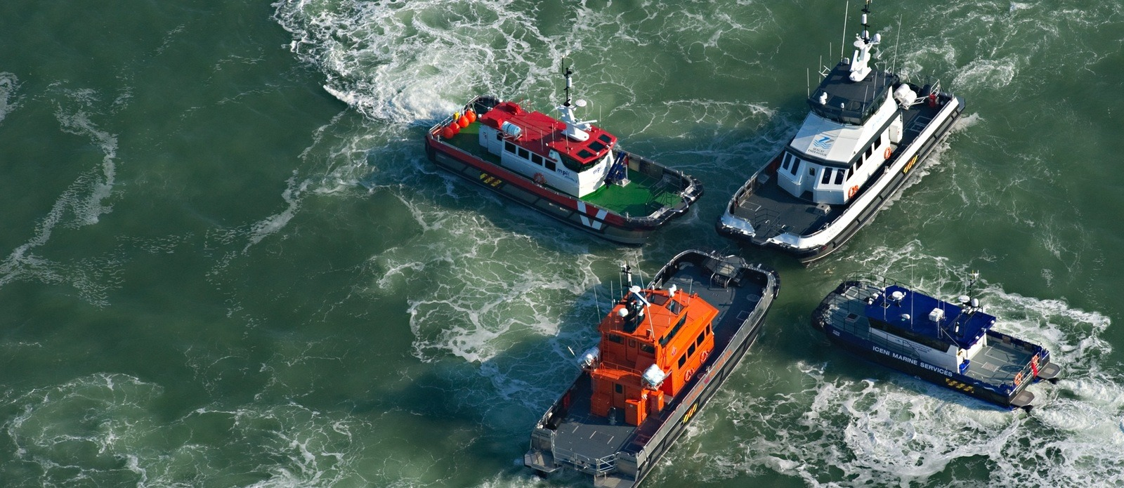 4btug boats in the water